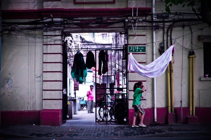 In Shanghai, the average working person lives in neighborhoods off of gated alleys. Within these communal areas people will cook, eat, wash and dry clothes, exercise and play cards and mahjong. Just a few blocks away are Gucci, Rolex and Prada stores catering to China's ultra-rich.