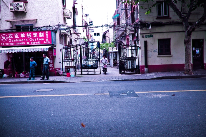 Gates lead to neighborhoods behind the main streets of Shanghai.