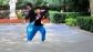 Woman practices Tai Chi with a sword, in Fuxing Park.