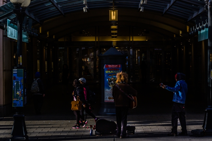 Buskers perform outside the Park Place Shopping  Center in downtown Seattle, Washington.
