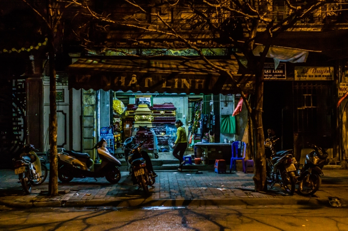Our first night in Hanoi, Vietnam. After stepping off a curb into a hole and spraining my ankle we walked--limped-- back to our hotel, never lost, but possibly bewildered, for the better part of an hour. One advantage of our mis-adventure was taking a wrong turn and stumbling--pun intended-- upon a couple of casket shops.