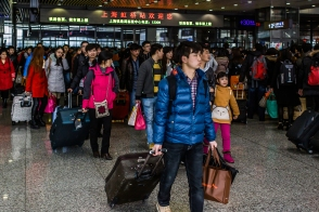 """Day Twenty-eight: The media in China covers """"the largest migration in human history,"""" aka Chinese New Year, aka Spring Festival, in the same way that American media covers Thanksgiving and Christmas holiday travel in the USA; lots of stati...See more — at Shanghai Hongqiao Railway Station"""