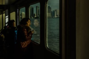 Day Twenty-six: I rode the ferry over to The Bund, this afternoon, to walk the Suzhou Creek area in the north part of Shanghai. These women were lined up at the door in order to be the first off when the boat docked. They are standing behind me, over my right shoulder and I am shooting their reflection in a mirrored window. I loved the afternoon light. (My favorite American artists is Edward Hopper; he loves windows, either looking in them, or looking out. The light they bring makes a picture.) — at Huangpu District, Shanghai