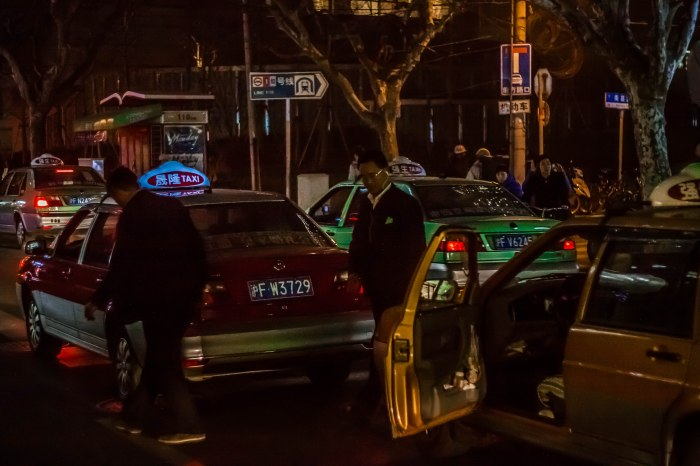 Cab drivers get out and inspect cars for damage.