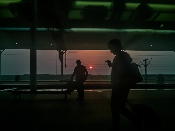 Sun sets on the Jinan train  station on the way to Beijing