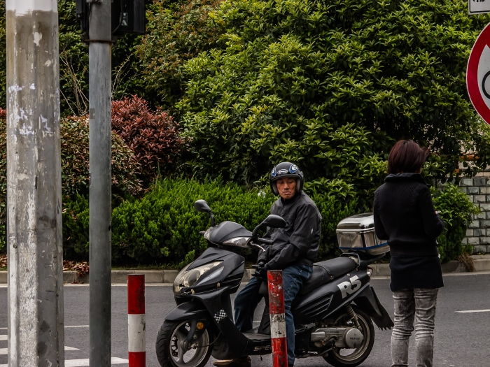 """Biker"" checks out woman waiting to cross the street."