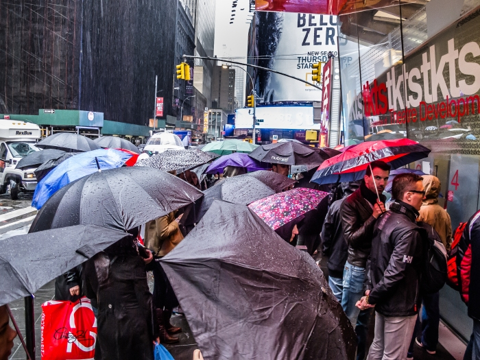 A scrum forms at the TKTS booth in Times Square