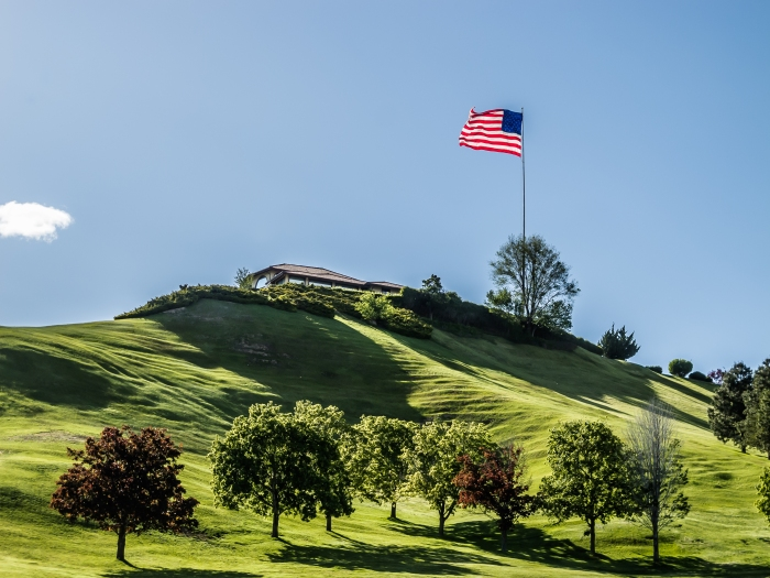 Gigantic United States flag flies over the Governor's mansion in Boise, Idaho, USA
