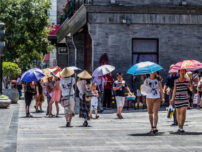 You see more umbrellas in Beijing on a sunny day than you do on a rainy day.