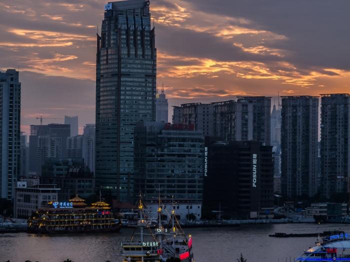 Sun sets behind the Huangpu River