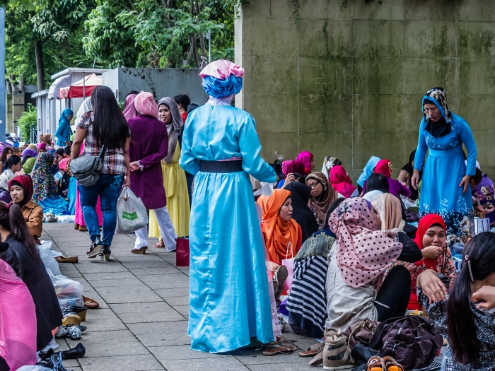 Indonesian women gather around Victoria Park, Hong Kong, for a holiday celebration.