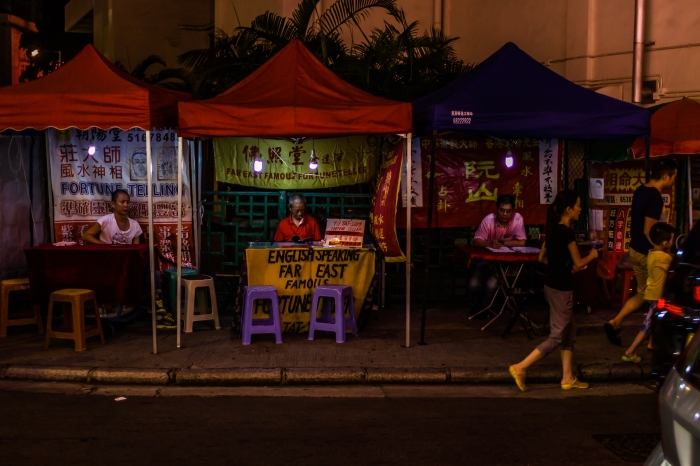 Fortune Tellers line the sidewalk at Temple Street Night Market, Hong Kong
