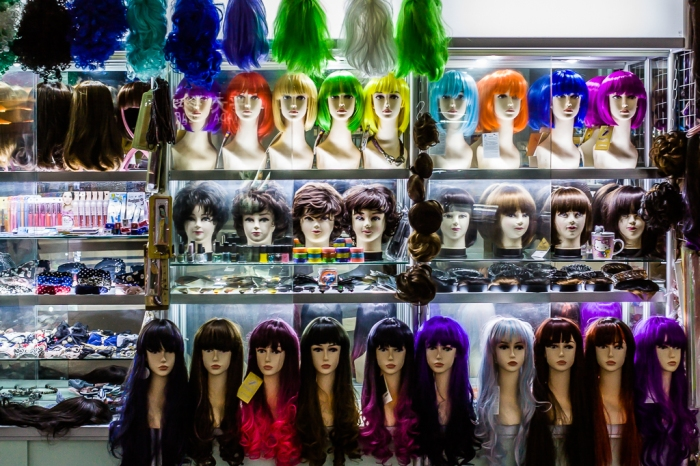 A wig vendor displays colorful wares at the AP Market in Shanghai.