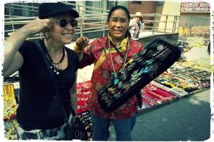 Tibetan woman sells jewelry outside the South Bund Fabric Market