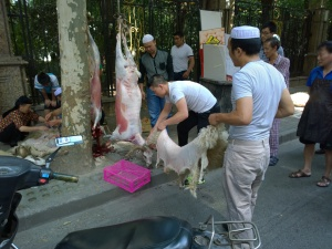 As part of Eid al-Fitr, Chinese Muslims butcher a sheep on a public street in Shanghai, China.