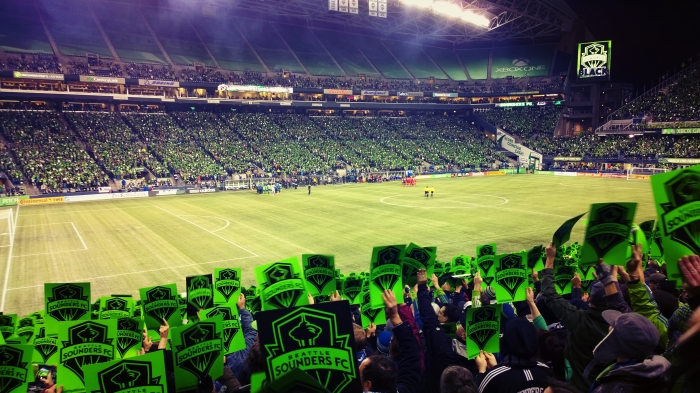 Fans flash cards in support of Seattle Sounders FC before the start of the semi-final playoff game against Dallas FC