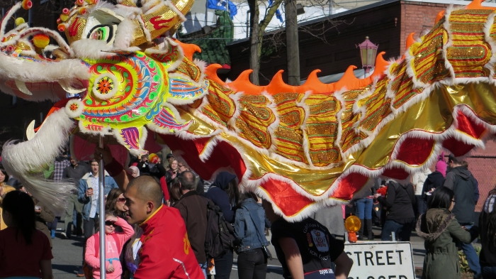 Dragon Dancers parade through the International District in Seattle.
