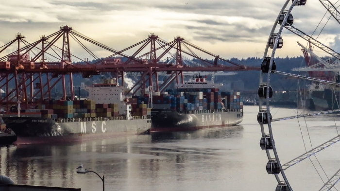 Container ship being unloaded, slowly, at a Seattle Dock.